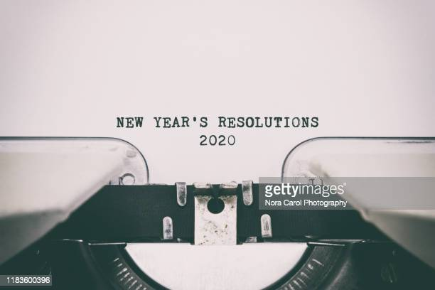 new year's resolutions 2020 text on a vintage typewriter - typewriter stock pictures, royalty-free photos & images