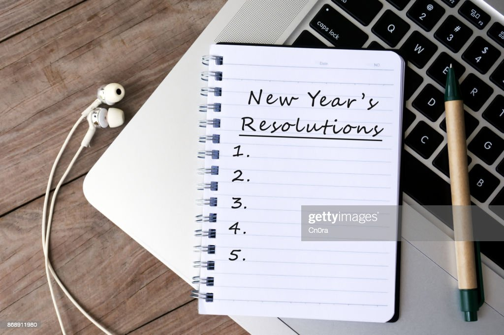New Year's Resolutions List on Notepad : Stock Photo