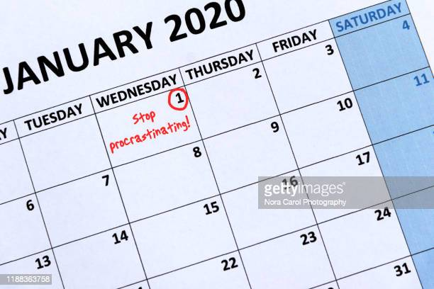 new year's resolutions stop procrastination - annual event stock pictures, royalty-free photos & images