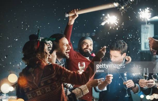 new year's rooftop party. - christmas party stock photos and pictures