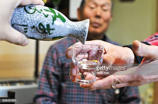 new year's sake - saki fotografías e imágenes de stock