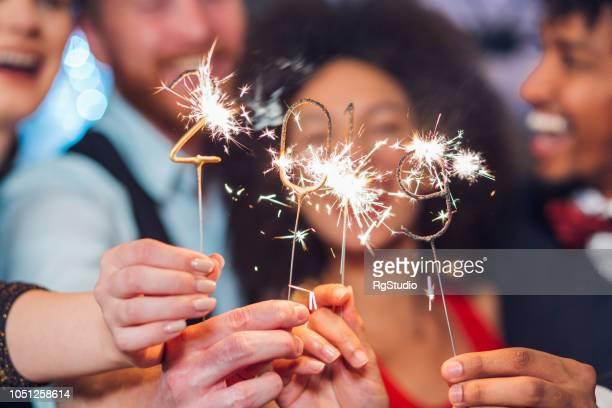 new year's sparklers - 2019 foto e immagini stock