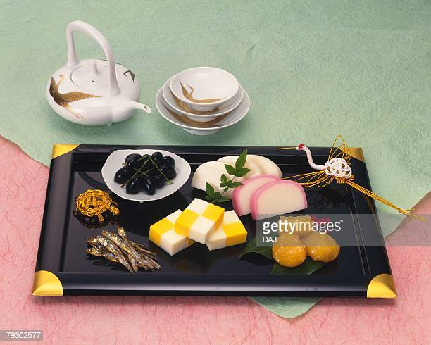 New Years spiced Sake and Japanese traditional New Years food on tray, high angle view