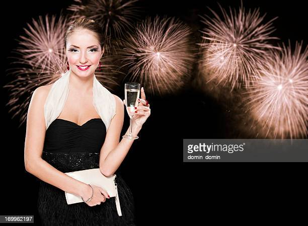 new year's woman with glass of champagne against fireworks, night - strapless dress stock pictures, royalty-free photos & images