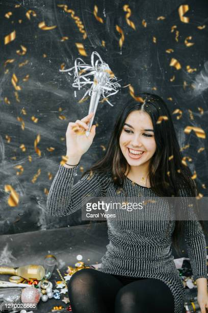 new years young woman having fun in xmas party with confetti - 16 17 years stock pictures, royalty-free photos & images