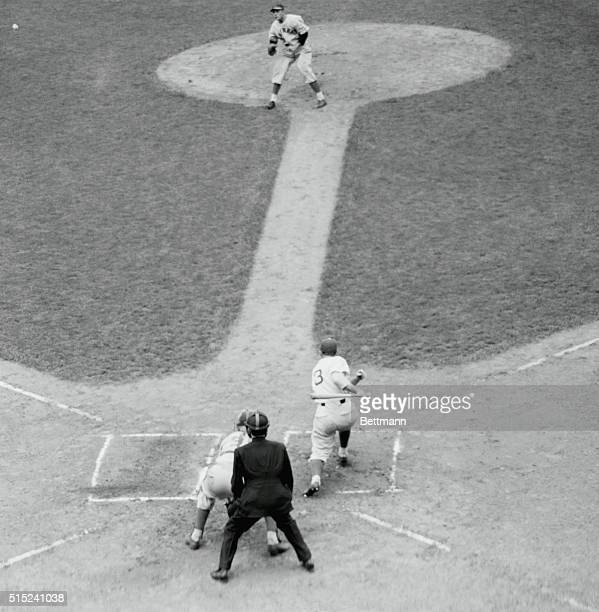 New York: A Hit Off Vander Meer---Jimmy Ripple, Giant right fielder, lines a single to left field off no-hitter Johnny Vander Meer at the Polo...