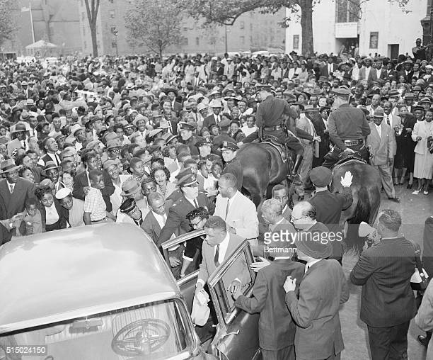 A huge crowd gathers around Mrs Mamie Bradley outside the Williams Institutional CME Church in Harlem today where a meeting was held to protest the...