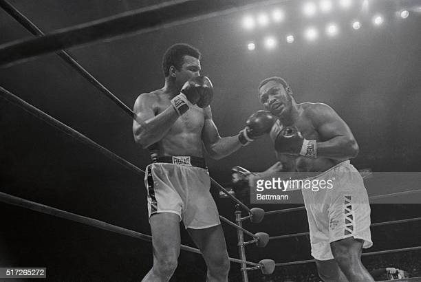 A Left To The Jaw A left to the jaw of Joe Frazier by Muhammad Ali puts a pained expression on the face of Frazier during their nontitle 12round bout...