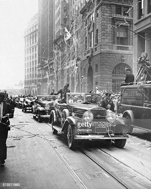Acclaimed as a conquering hero Bobby Jones rides triumphantly down Broadway in New York City following his return from England where he captured both...