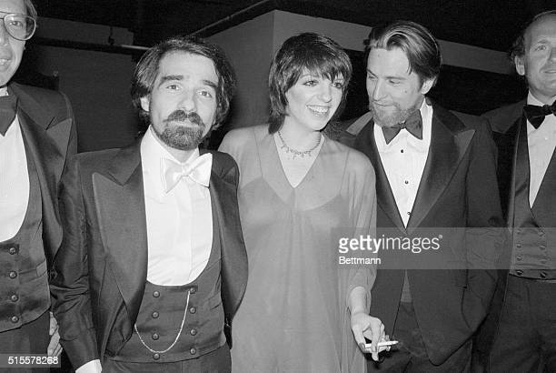 New York: Actress Liza Minnelli, actor Robert DeNiroand director Martin Scorsese joke in the reception line at Alice Tully Hall, June 21, where their...