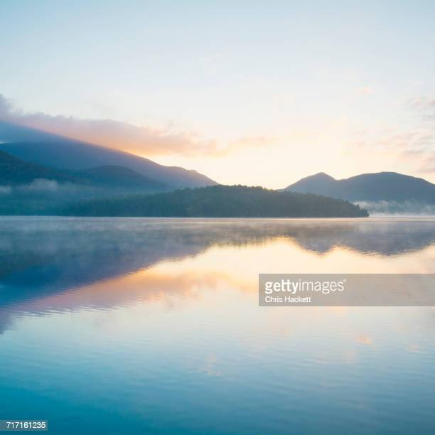 usa, new york, adirondack mountains, lake placid at sunrise - horizon over land stock photos and pictures