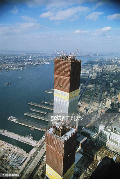 Airview of one of the two towers of the World Trade Center as workers put into place steel sections which brought the building to a height of 1254...