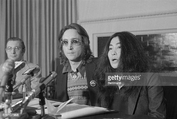 Announces 'Nutopia' 'Beatle' John Lennon and wife Yoko Ono wave 'functional' white flags at news conference here April 2nd They also announced start...