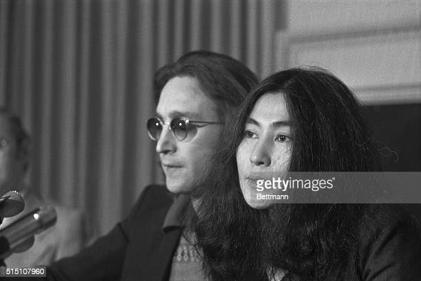 Announces 'Nutopia' John Lennon and wife Yoko Ono wave 'functional' white flags at news conference here April 2nd They also announced start of series...