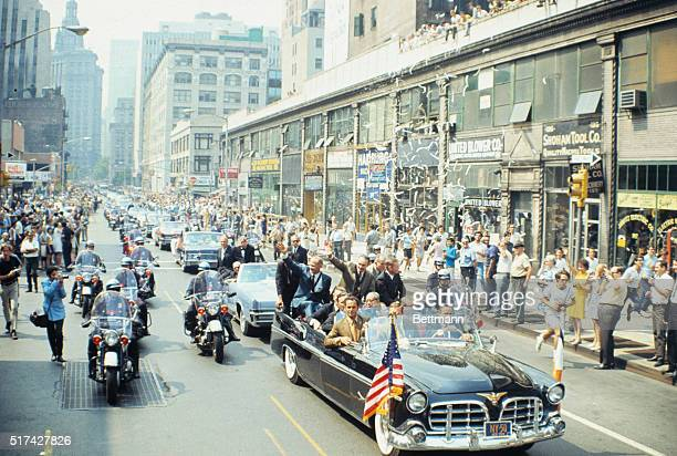 Apollo 11 astronauts wave from open car after City Hall ceremonies here Left to right Michael Collins Buzz Aldrin and Neil Armstrong In front of them...