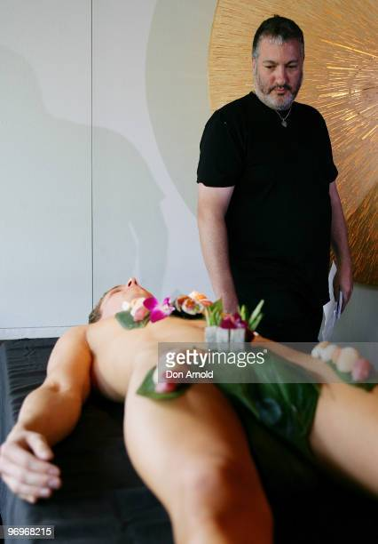 New York artist Spencer Tunick poses whilst standing over a model dressed only with sushi during a press conference at the Toko Restaurant Bar on...