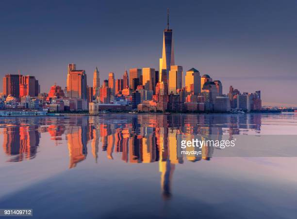 new york at sunrise - capital cities stock photos and pictures