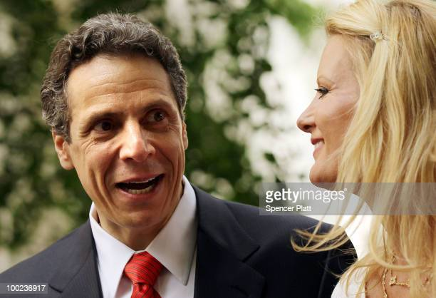 New York Attorney General Andrew Cuomo stands on stage in the park with his girlfriend Food Network host Sandra Lee following his announcement to...