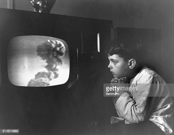 Awestruck At TV View Of ABlast Little Raymond Carlin of the Bronx is held spellbound before his television screen as he watched the awesome spectacle...