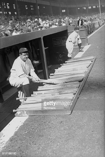 Babe Ruth selecting a bat before hitting one of his well known home runs at the Yankee Stadium yesterday on the occasion of the opening of the Yankee...