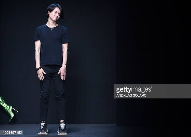 New York based Chinese designer Han Wen acknowledges applause following the presentation of his Fall Winter 2020 collection as part of the China We...