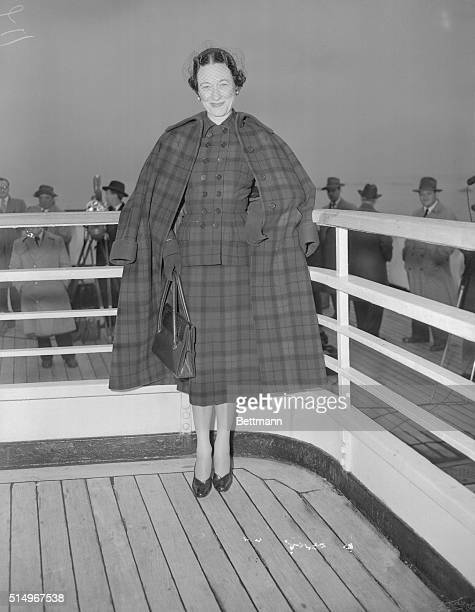 'Best Dressed Duchess Of Windsor Arrives' The Duchess of Windsor wearing a red and blue plaid suit and coat to match is shown as she arrived in New...
