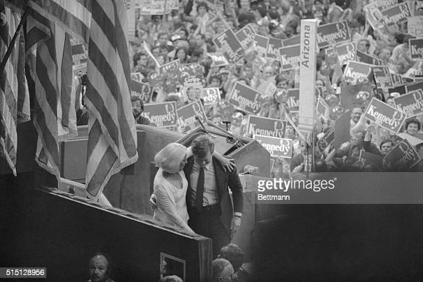 Best of 1980 With supporters demonstrating in the background Sen Edward Kennedy walks slowly from the podium with his wife Joan after his rousing...