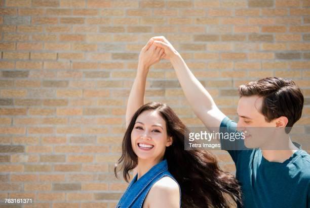 New York, Brooklyn, Man twirling girlfriend