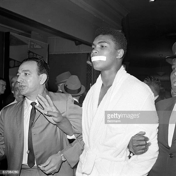 3/13/63 New York Cassius Clay's mouth is shut or at least covered with tape as he arrives for weighin here 3/13 for his heavyweight bout with Doug...