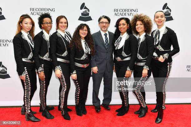 New York Chapter of The Recording Academy executive director Nick Cucci poses with the musical group Flor de Toloache at the 60th GRAMMY Nominee...