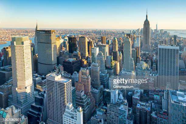 new york city aerial skyline at dusk, usa - rockefeller centre stock pictures, royalty-free photos & images