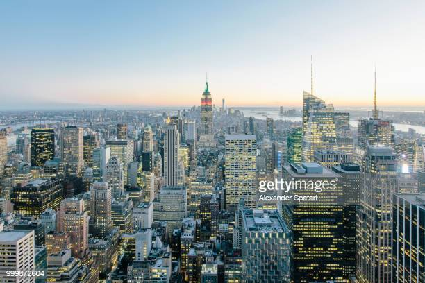 New York city aerial view with illuminated skyscrapers at dusk, New York, USA