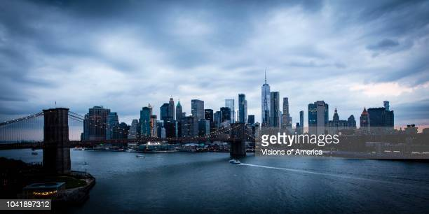 New York City and East River shows Brooklyn Bridge and Manhattan Skyline as seen from Queens