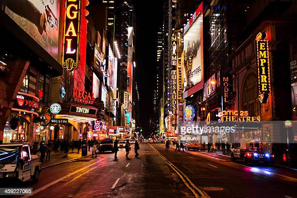 new york city at night - broadway manhattan stock photos and pictures