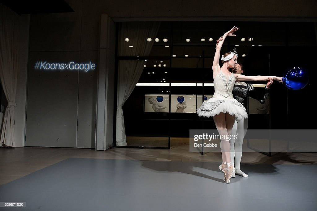 New York City Ballet dancers Ashley Laracey (L) and Troy Schumacher perform during the Jeff Koons x Google launch on May 09, 2016 in New York, New York.