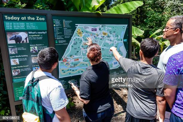 New York City Bronx Zoo People looking at map