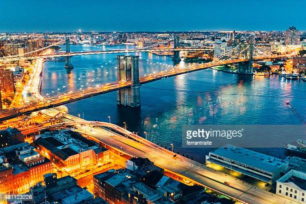 new york city brooklyn bridge and manhattan bridge aerial view - dumbo stock photos and pictures