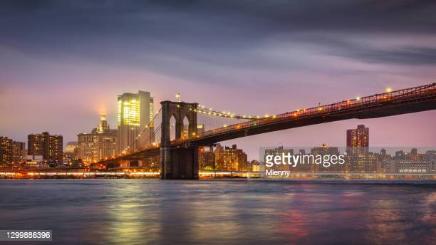 new york city brooklyn bridge at night east river twilight panorama nyc - brooklyn new york stock pictures, royalty-free photos & images