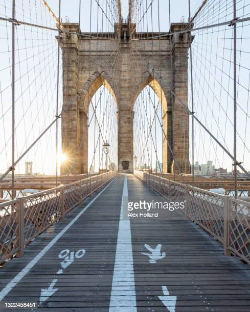 usa, ny, new york city, brooklyn bridge footpath and bike lane at sunset - manhattan new york city stock pictures, royalty-free photos & images
