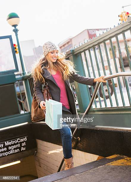 usa, new york city, brooklyn, williamsburg, portrait of blond woman leaving subway station - williamsburg new york city stock pictures, royalty-free photos & images