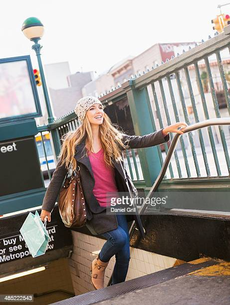 usa, new york city, brooklyn, williamsburg, portrait of blond woman leaving subway station - new york city subway stock pictures, royalty-free photos & images