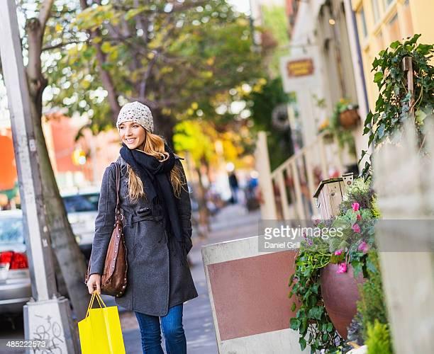 USA, New York City, Brooklyn, Williamsburg, Portrait of blond woman walking on sidewalk