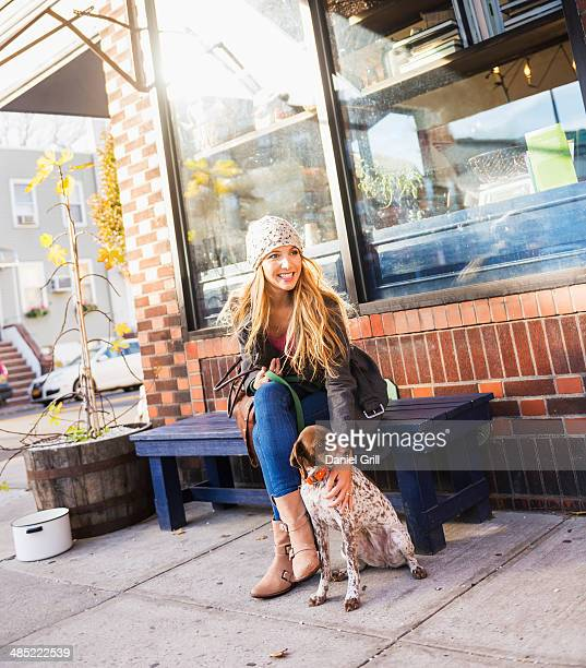 USA, New York City, Brooklyn, Williamsburg, Portrait of blond woman with dog