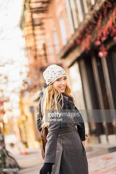 USA, New York City, Brooklyn, Williamsburg, Portrait of woman on sidewalk
