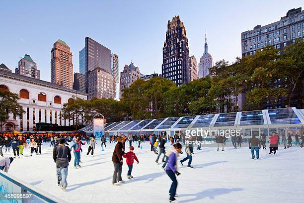new york city. bryant park ice-skating - bryant park stock pictures, royalty-free photos & images