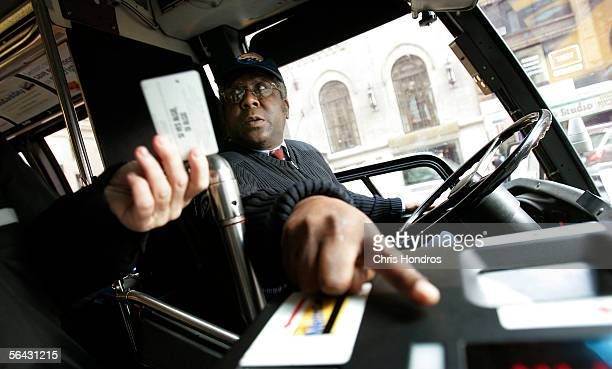 New York City bus driver David Smith points out how to use the fare system to a passenger December 14 2005 in New York City New York City Transit...