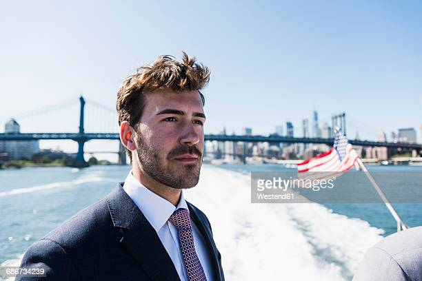 USA, New York City, businessman on ferry on East River