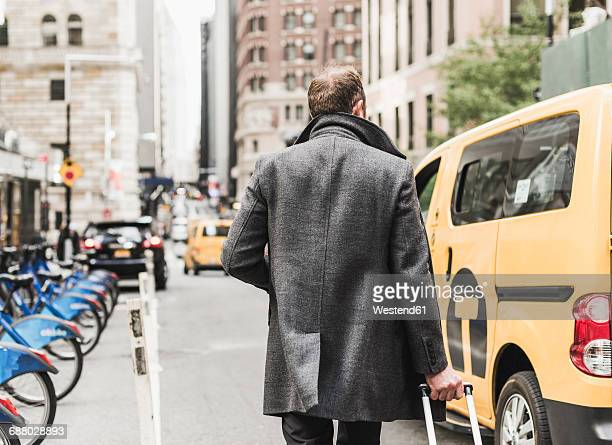 USA, New York City, businessman on the move in Manhattan