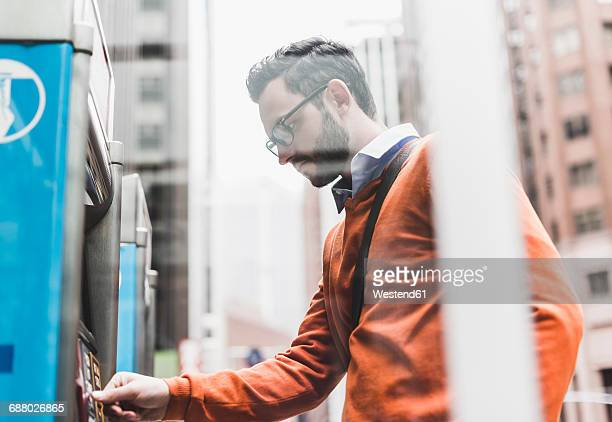 USA, New York City, Businessman using ATM