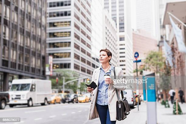 usa, new york city, businesswoman in manhattan on the go - one mature woman only stock pictures, royalty-free photos & images